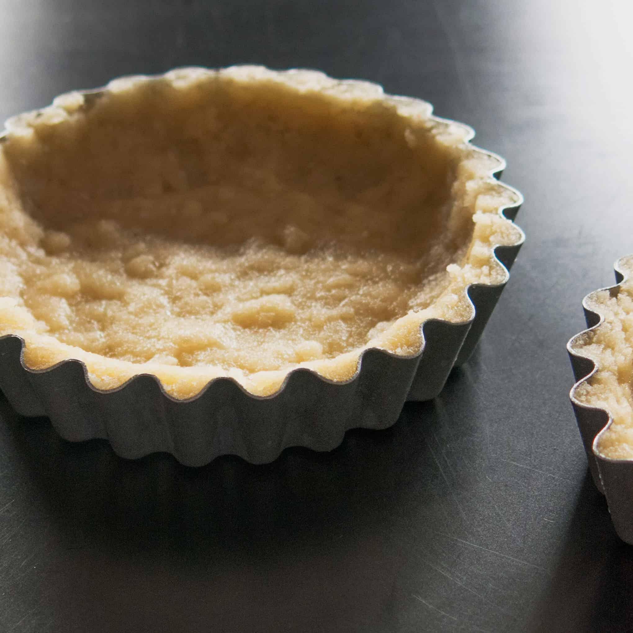 Gluten free, vegan sweet almond tart case - baked ready for filling.