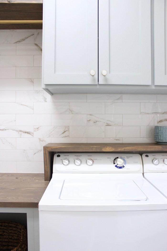 laundry room-diy-waterfall-shelf-above-washer-dryer
