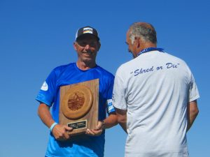 Skippy gets a a trophy from Bill