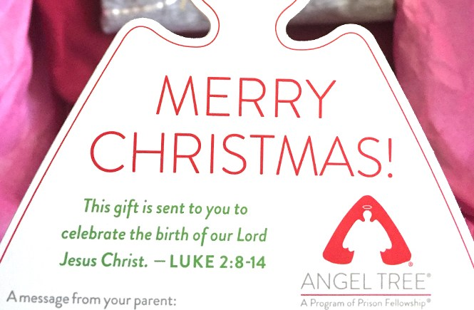 """Close up of an Angel Tree angel with the headline, """"MERRY CHRISTMAS"""""""