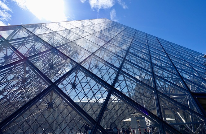 Photograph of the glass pyramid outside of the Musee de lLouvre.
