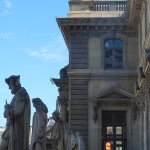 Statues overlook a courtyard.
