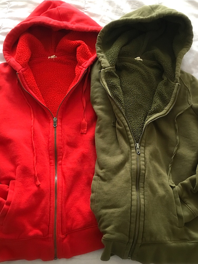 Photo of a red and green sherpa lined hoodie.