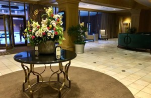 Royal Sonesta hotel lobby featuring a round table with large floral display in Baltimore, MD.