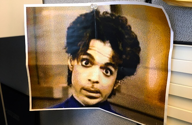 Close up photograph of a printed picture of Prince's face.