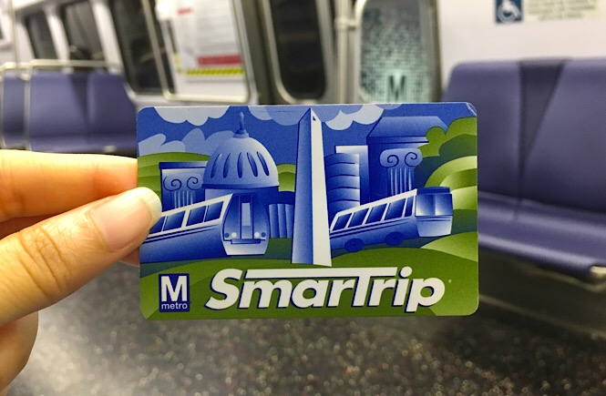 Photo of fingers holding a SmartTrip card inside the metro.
