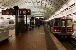 Photo of a metro car on a platform.