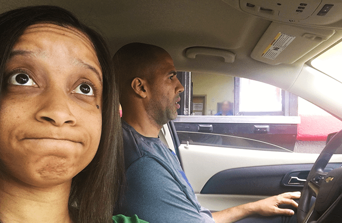 Photo of Hun and I waiting in the drive-thru line at Popeyes for a chicken sandwich.