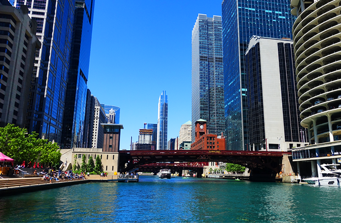 Photo of tall buildings on the Chicago river.