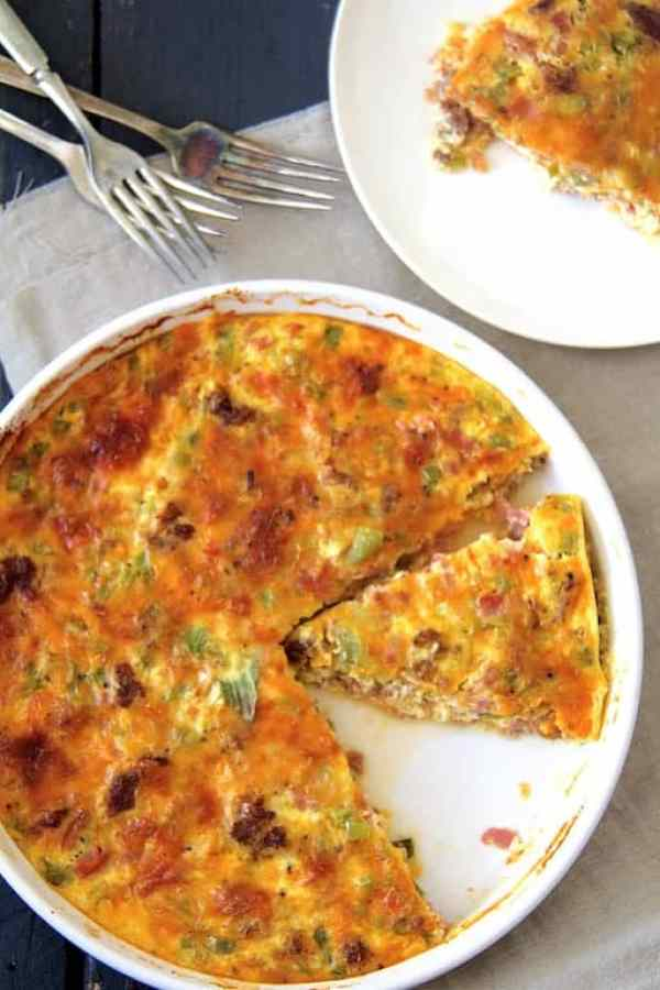 Crustless Quiche with Sausage, Bacon and Ham - Overhead shot of quiche sliced and a piece removed