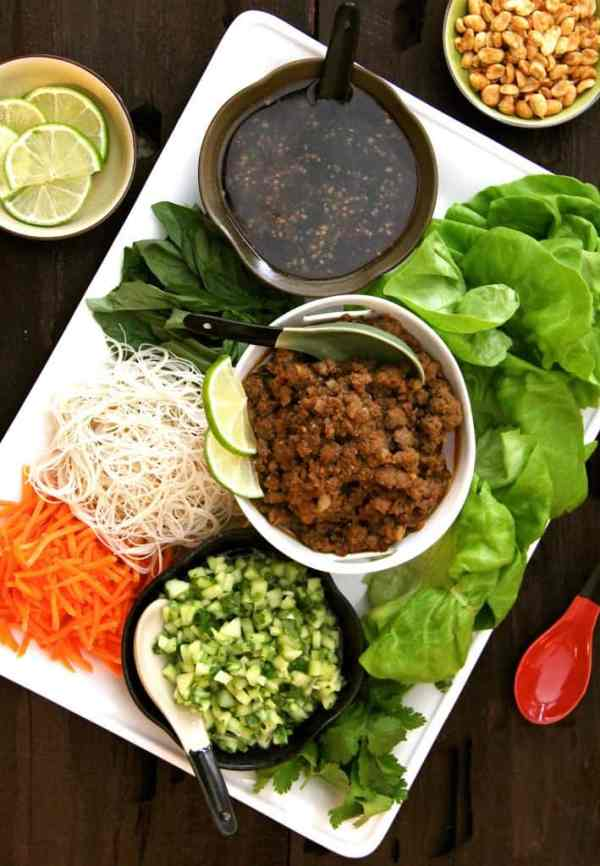 Vietnamese Beef Lettuce Wraps with Rice Noodles and Cucumber Relish - Overhead shot of entire dish on white platter with all the accompaniments