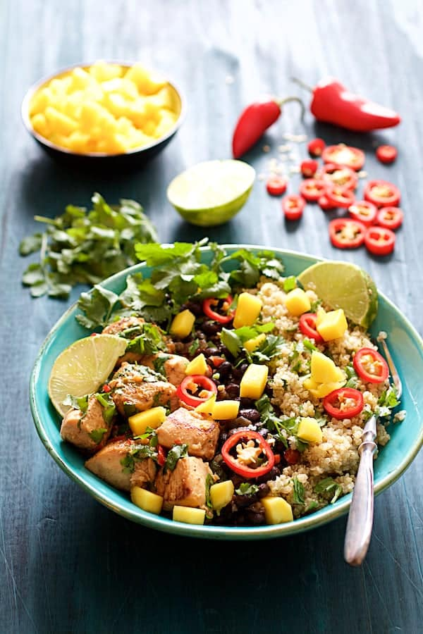 Cuban Chicken and Black Bean Quinoa Bowls - Straight-on shot with garnishes in the background