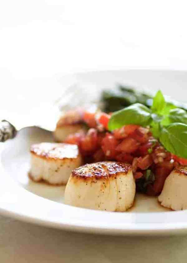Seared Sea Scallops with Tomato, Red Onion and Balsamic Salsa - Close-up shot of scallops with salsa in the background