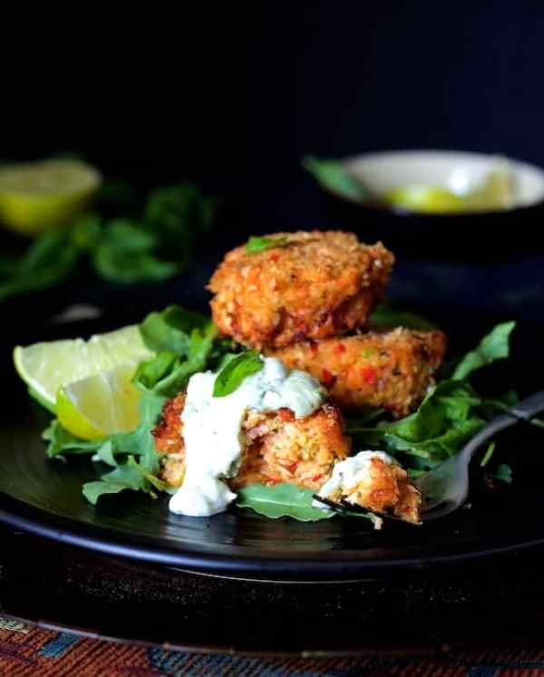 Thai Salmon Cakes with Basil - Lime Mayonnaise - Close-up hero shot with some of the salmon cake on a fork