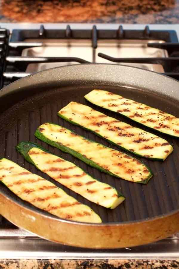 Zucchini being grilled in grill pan