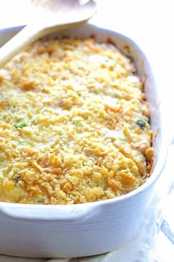 Layered Zucchini Corn Casserole - Close-up shot of casserole in white baking dish