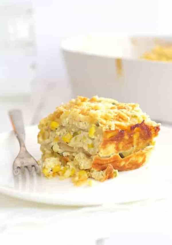 Layered Zucchini Corn Casserole - Piece of casserole on white dish