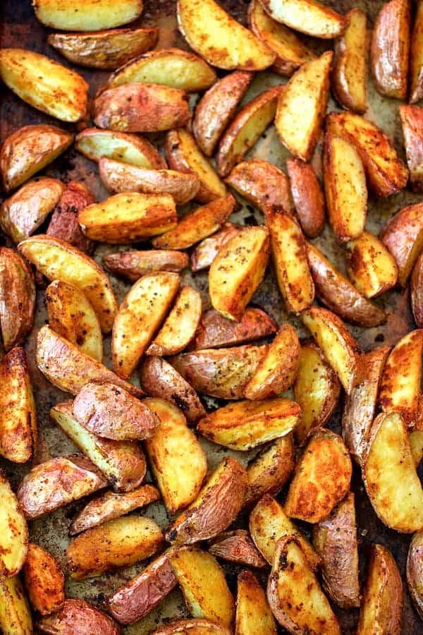 Perfect Roasted Potato Wedges - Overhead shot of roasted potatoes on baking sheet