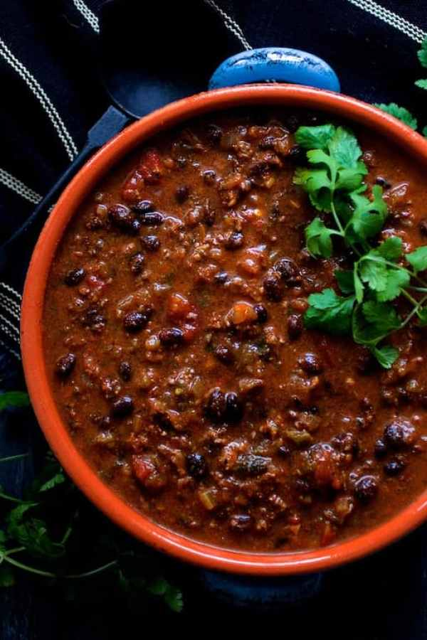 Beef and Chorizo Chili with Black Beans - Overhead shot of chili in blue clay bowl