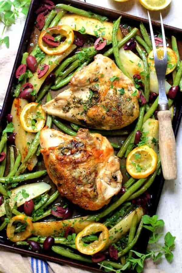 Sheet Pan Roast Chicken with Potatoes Green Beans Olives and Lemon - Overhead shot taken at slightly different angle garnished with fresh oregano