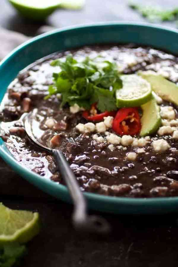 Slow Cooker Black Bean Soup with Ham - Straight-on view of soup in blue bowl