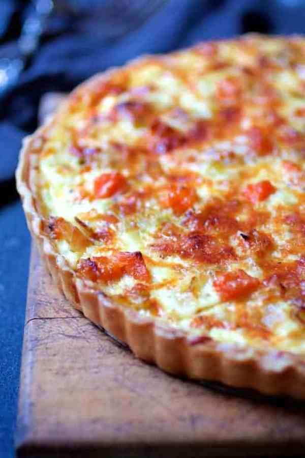 Butternut Squash, Leek and Gruyere Tart - Close-up of baked tart on wood cutting board