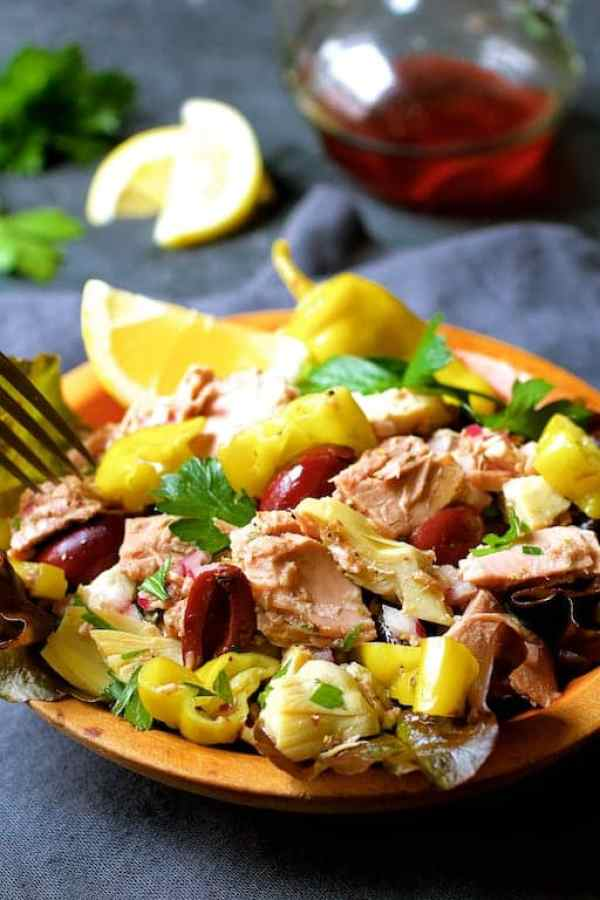 Quick Pantry Mediterranean Tuna Salad with fork in wooden bowl