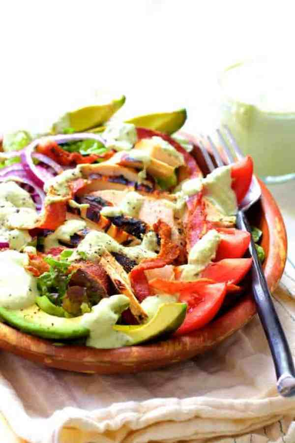 Chicken BLT Salad with Spicy Avocado Ranch Dressing - Hero shot of salad in wood bowl