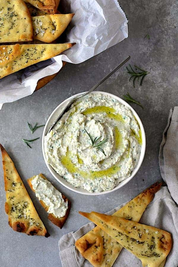 White Bean and Artichoke Spread with Rosemary Sea Salt Flatbread Chips - Top Down Hero Shot