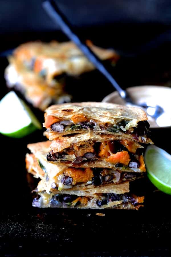 Sheet Pan Sweet Potat, Poblano and Black Bean Quesadillas with Chipotle Sour Cream - Hero shot with four pieces of the quesadilla stacked four high