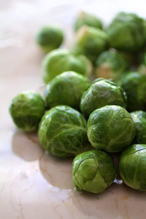 Quick Pickled Brussels Sprouts with Jalapeno - Fresh Brussels sprouts on marble surface