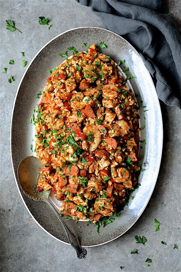 Low Carb Jambalaya with Chicken Shrimp and Sausage - Overhead shot on gray-rimmed platter