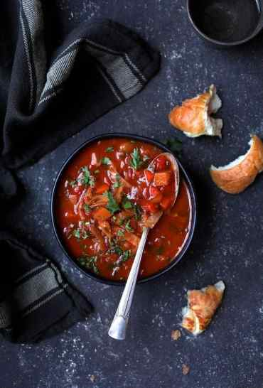 Russian Cabbage Soup (Shchi) overhead shot with striped towel and crusty bread