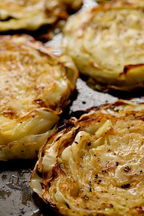 Roasted Cabbage Steaks with Mustard Vinaigrette - Close-up of roasted steaks on baking sheet