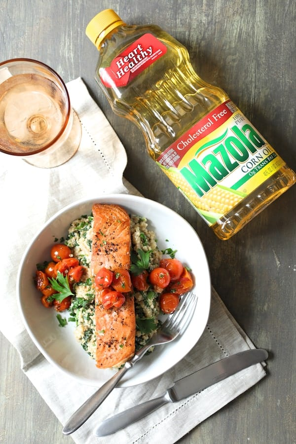 Seared Salmon with Baby Kale Quinotto and Warm Roasted Cherry Tomato Salad - Overhead shot of finished dish with bottle of Mazola oil