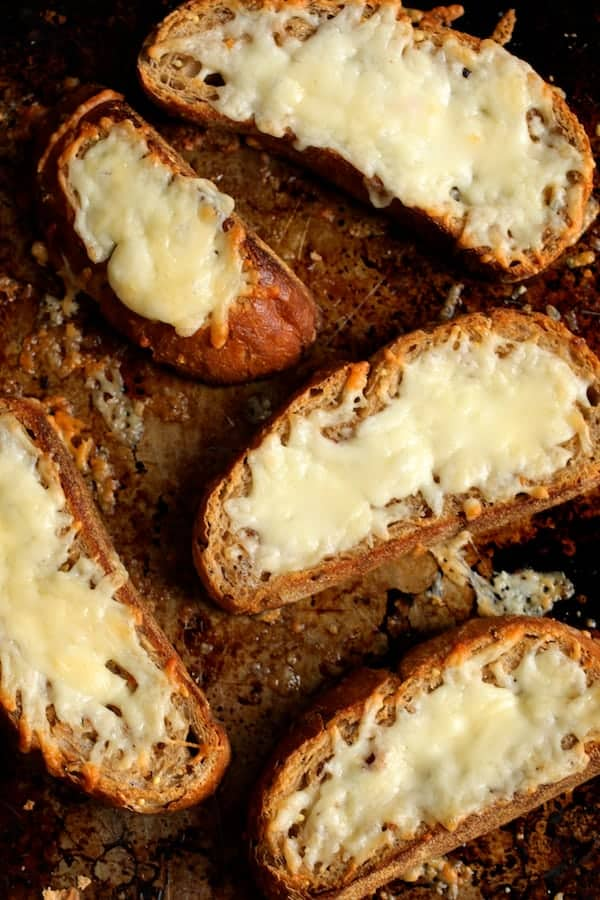 Soupy Spanish Lentils with Chorizo and Manchego Toast - Photo of cheesy toast