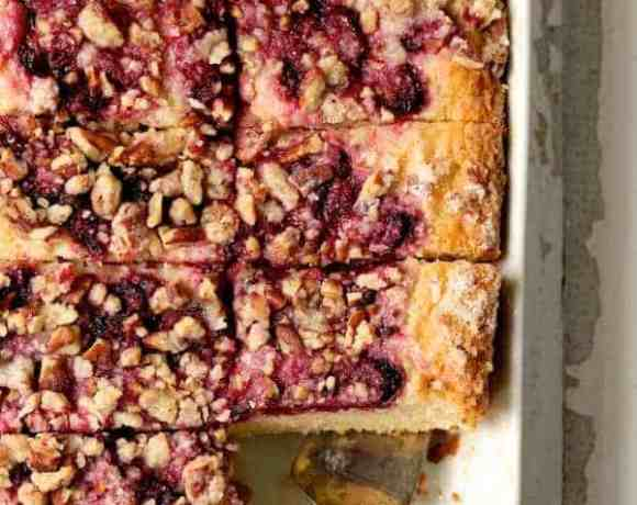 Easy Raspberry Coffee Cake - In white baking pan, cut into pieces with silver server