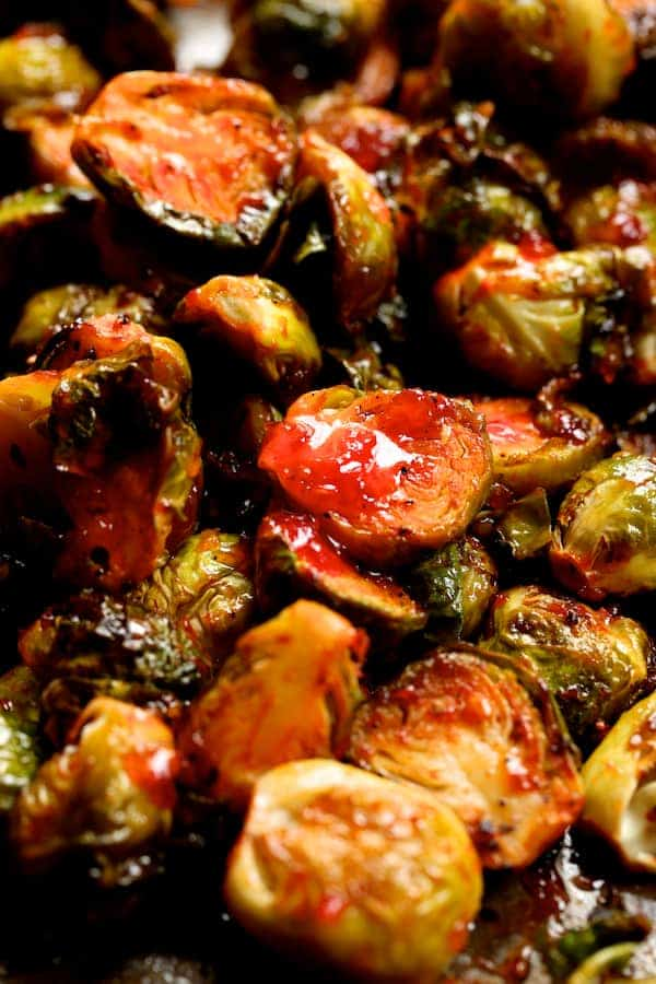 Sriracha Sweet Chili Roasted Brussels Sprouts - After roasting being drizzled with sweet chili sauce