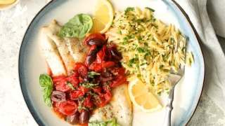 Baked Fish with Cherry Tomato Olive Sauce + Lemon Chive Asiago Orzo