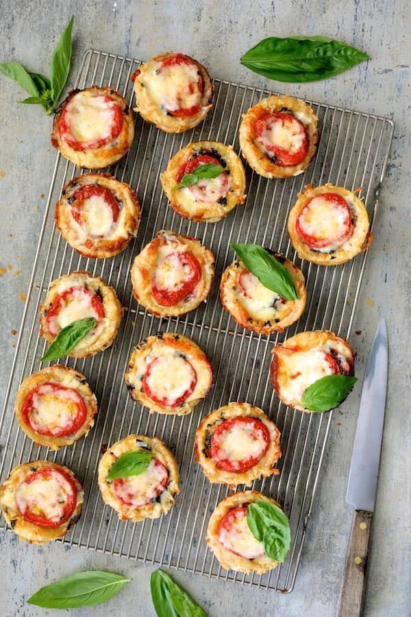 Mini Southern Tomato Pies - Overhead shot of baked mini pies on cooling rack removed from muffin tin