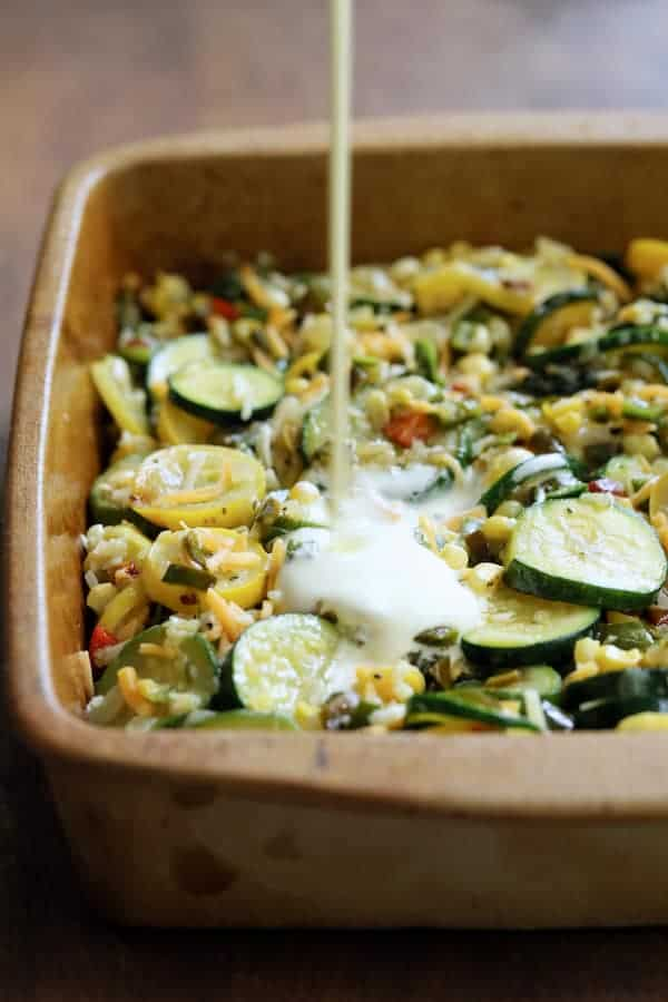 Southwestern Squash Corn and Poblano Casserole - Egg mixture being poured over casserole