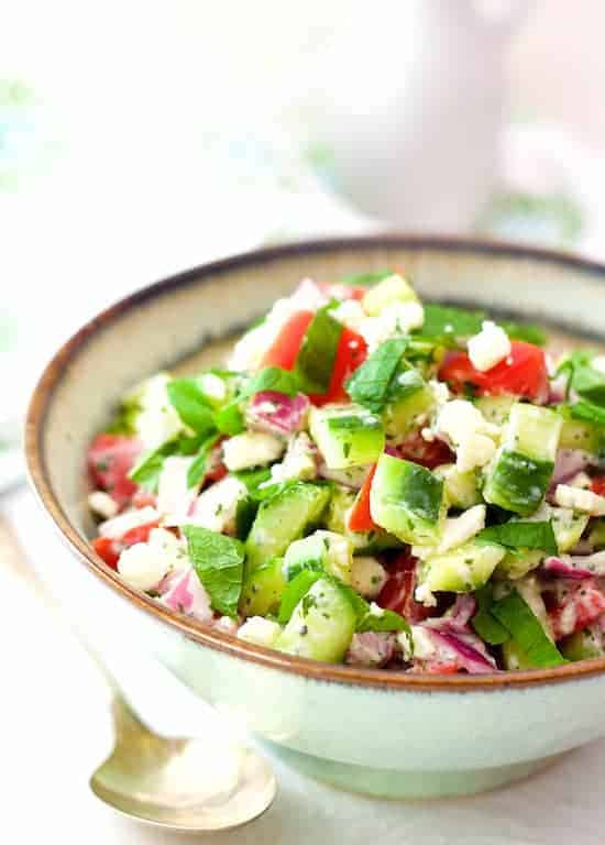 Cucumber Tomato and Red Onion Salad with Yogurt Mint Dressing and Feta Cheese is the perfect side dish for grilled meat, poultry or fish. Enjoy it on it's own or pop it in a pita and you've got a great lunch! #cucumber #tomato #redonion #yogurt #mint #salad #vegetariansalad #vegetablesalad