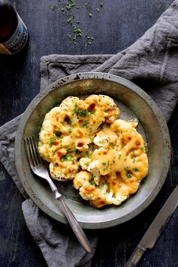Cauliflower Welsh Rarebit - Overhead hero shot of cauliflower steaks in serving dish