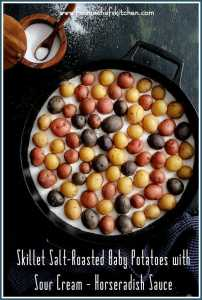 """Skillet Salt-Roasted Baby Potatoes with Sour Cream Horseradish Sauce makes a fun side dish or party appetizer! Salt-roasting makes the skins super crispy, the interior beautifully creamy and it's the perfect cooking method for baby or """"peewee"""" potatoes."""
