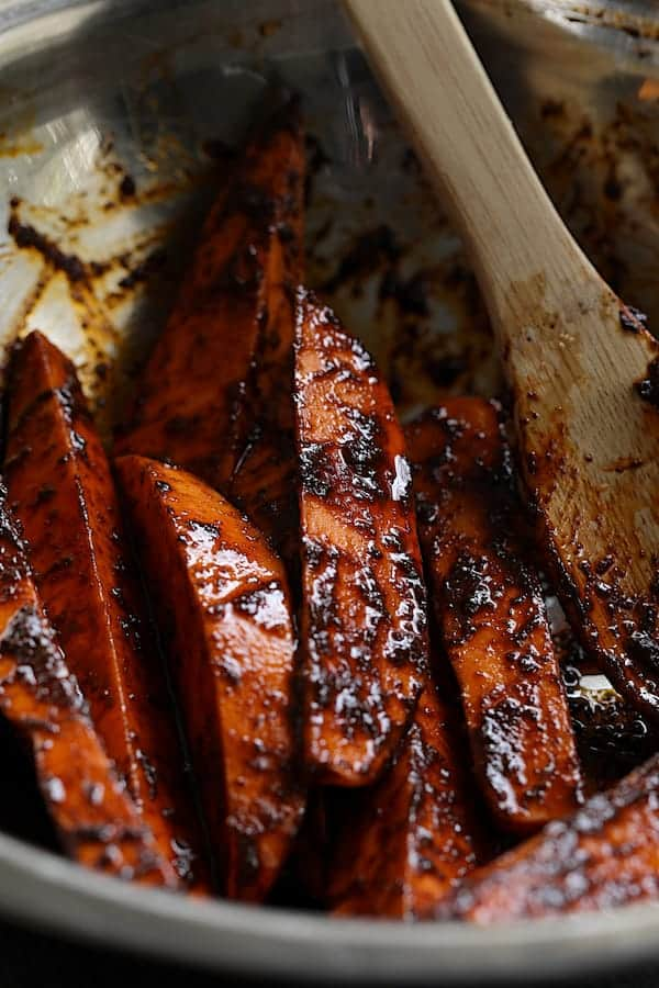 Spicy Tahini Pork Medallions with Harissa Roasted Sweet Potato Wedges - Sweet potato wedges before being roasted tossed with harissa paste