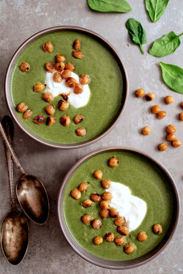 Spinach and Goat Cheese Bisque with Crispy Lemon Chickpeas - Overhead close-up shot of two bowls of soup