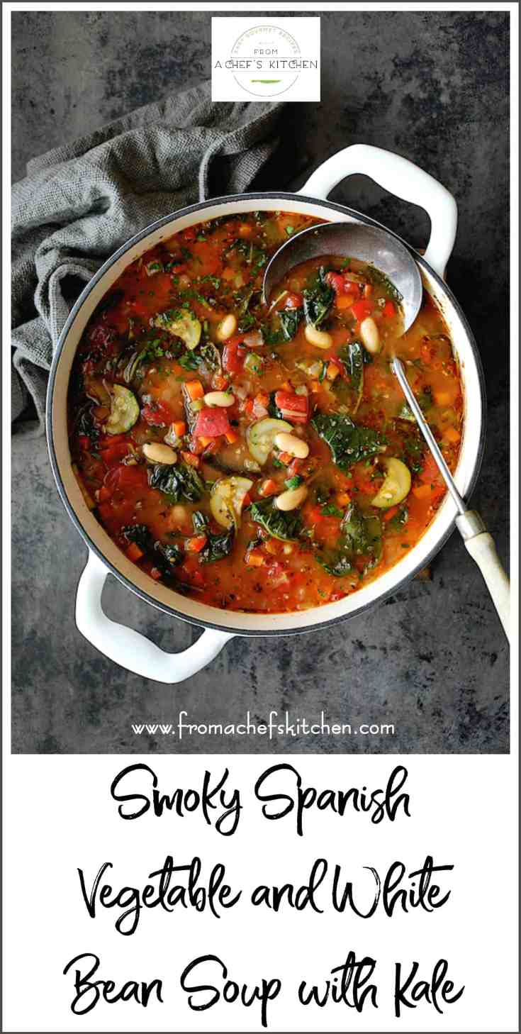 Smoky Spanish Vegetable and White Bean Soup with Kale is both hearty and healthful! It's the perfect late-winter-into-early-spring soup that's sure to take the chill off but not weigh you down! #spanish #vegetable #whitebean #cannellinibean #kale #soup