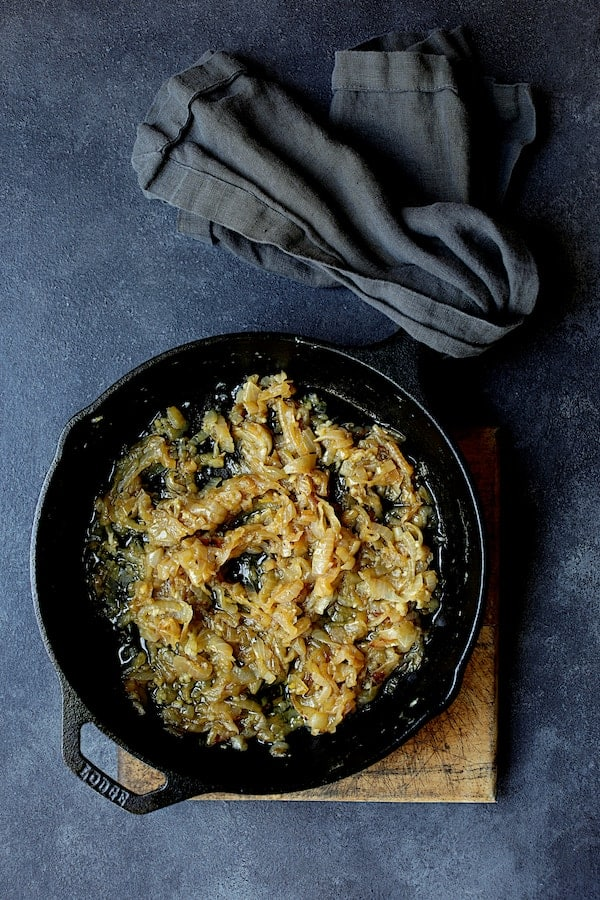 Turkish Eggplant Casserole - Imam Bayildi - Overhead shot of cooked onions in cast iron skillet