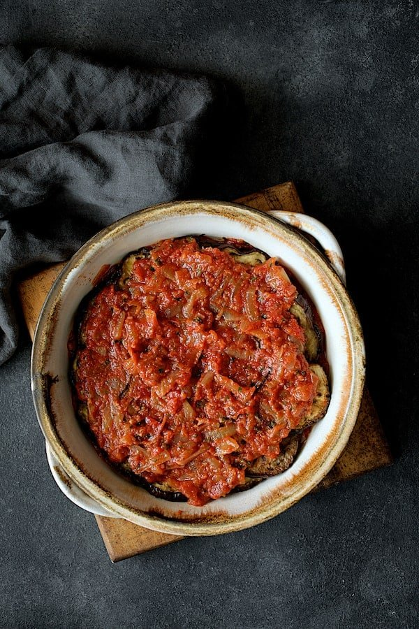 Turkish Eggplant Casserole - Imam Bayildi - Overhead shot of another layer of tomato sauce over the eggplant