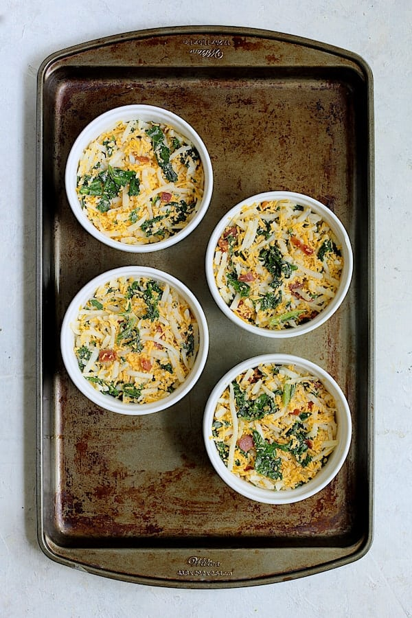 Hash Brown Frittata with Kale, Bacon and Cheddar - Overhead shot on baking sheet before custard is poured in